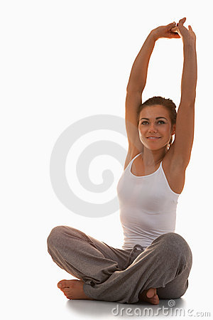 Portrait of a fit woman stretching her back