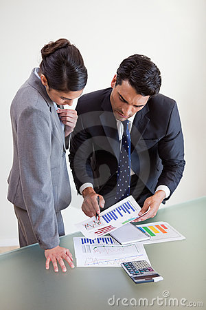 Portrait of focused sales persons studying statistics