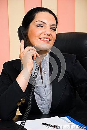 Portrait of formal businesswoman talk by phone