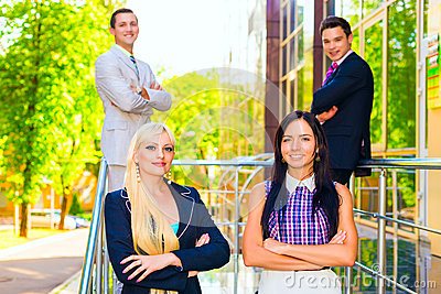 Portrait of four business people