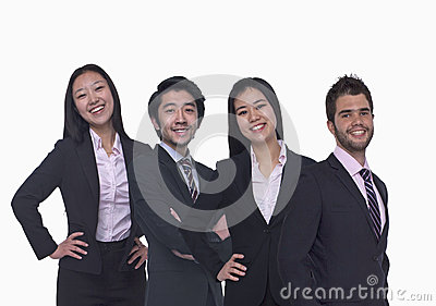 Portrait of four young business people looking at the camera, three quarter length, studio shot
