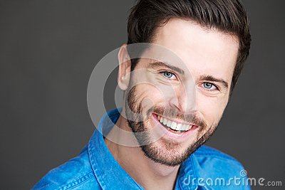 Portrait of a friendly young man with happy expression