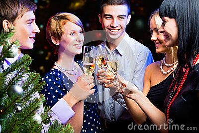 Portrait of friends celebrating New Year