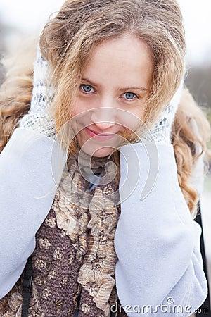 Portrait of a frozen woman heated by wool mittens