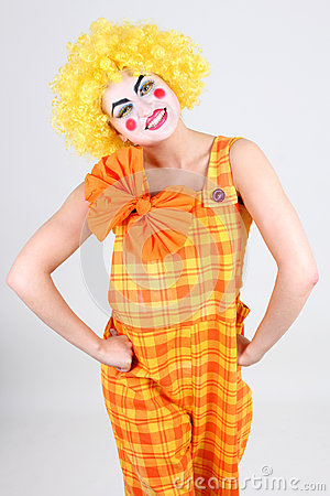 Portrait of funny clown with bow