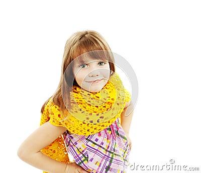 Portrait of funny lovely little girl wearing scarf