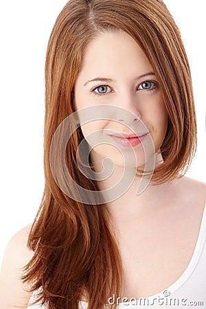 Portrait of gingerish teenage girl smiling