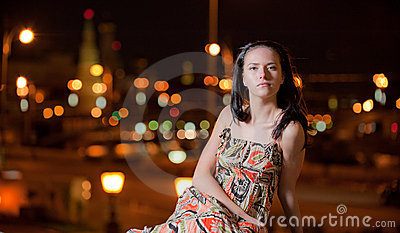 Portrait of girl against night city