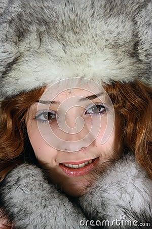 Portrait of girl in arctic fox cap