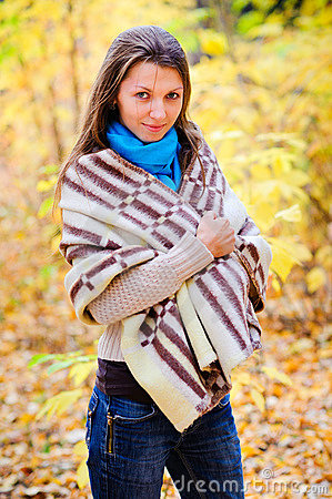 Girl with a blanket in autumn forest