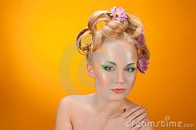 Portrait girl  blonde with flowers in her hair