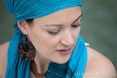 Portrait of a girl with a blue headscarf