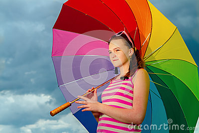 Portrait of  girl with colorful umbrella