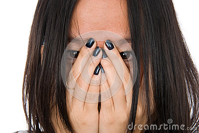 Portrait girl in despair shuts face with hands