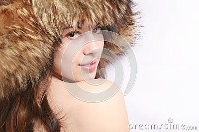 Portrait of the girl in a fur cap.