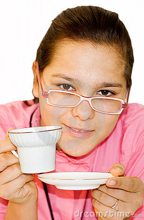Portrait of girl. The girl drinks orange tea