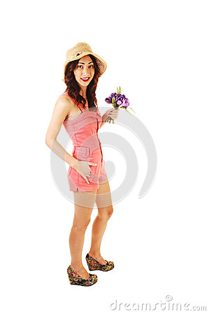 Portrait of girl with hat and flowers.