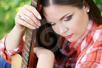 Portrait of girl with her guitar
