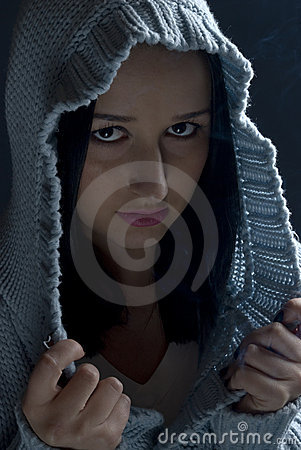 Portrait of girl in hood in dark