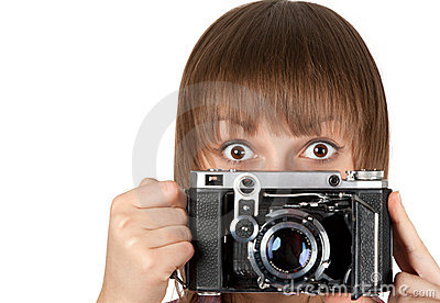 Portrait girl with old photo by camera