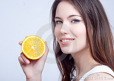 Portrait of a girl with an orange