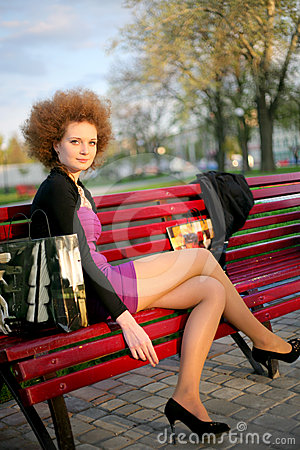 Portrait of a girl in the park after shopping