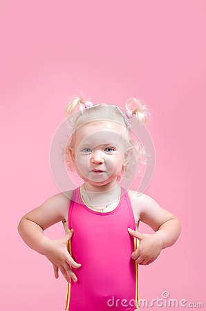 Portrait of a girl in a pink bathing suit