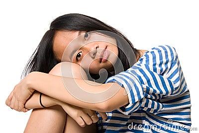 Portrait of girl put head on knees