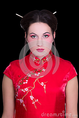 Portrait of girl in red japanese dress  isolated on black
