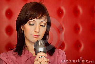 Portrait of girl in red shirt with microphone