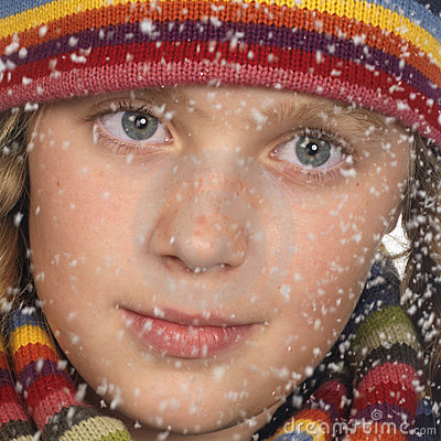 Portrait of a girl s face while snowing