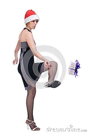Portrait of girl in santa hat kick a gift