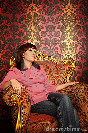 Portrait of girl sitting in armchair. Retro style