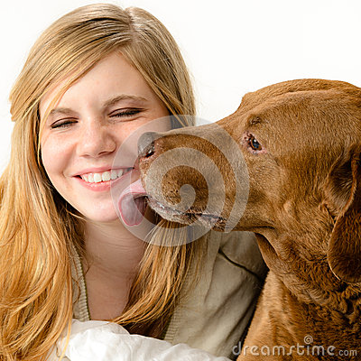 Portrait of girl snuggling with her dog