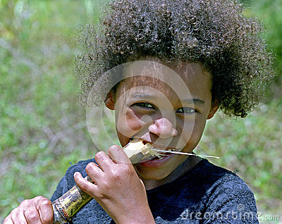 Portrait of girl with stalk sugarcane, Brazil Editorial Image