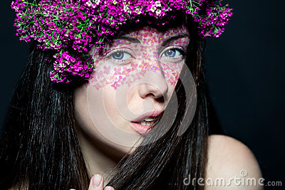 Portrait girl with stylish make-up and flowers