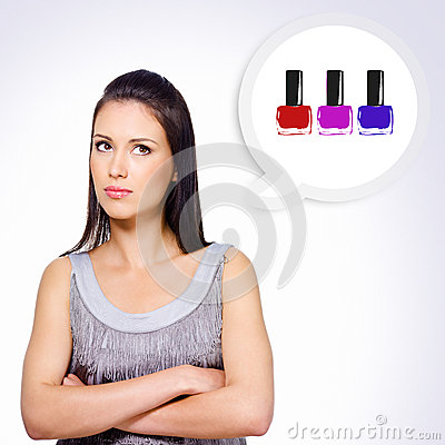 Portrait of  girl thinking about buying cosmetics