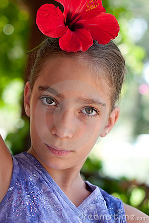 Portrait of a girl wearing flower in her hair