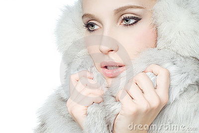 Portrait of girl wearing white fur