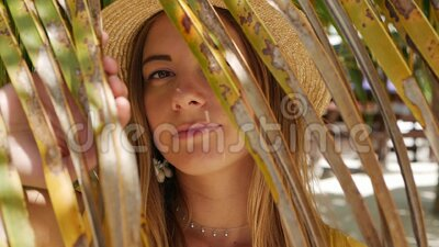 Portrait of a girl in a hat in an exotic country. Portrait of a girl in white earrings on ears hat on her head exotic stock footage
