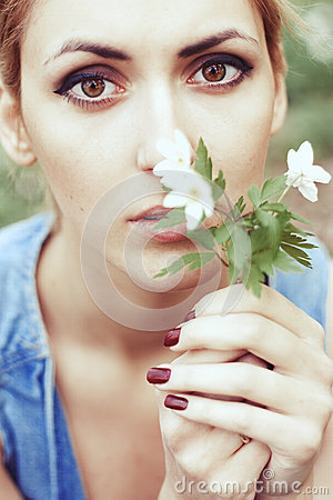 Portrait of girl with white spring flowers