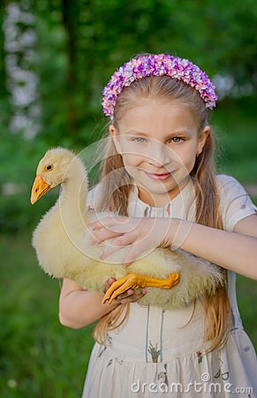 Free Portrait Girl With Duckling Holding Royalty Free Stock Photos - 116122538