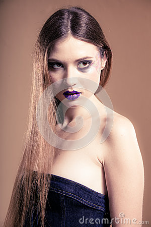 Portrait of girl woman with long straight hair and creative makeup Stock Photo