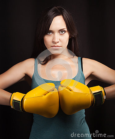 Portrait of a girl in yellow boxing gloves