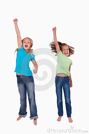 Portrait of girls jumping with their fists up