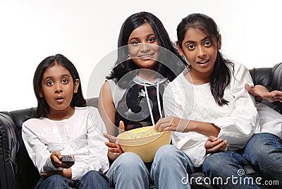 Portrait of Girls watching TV