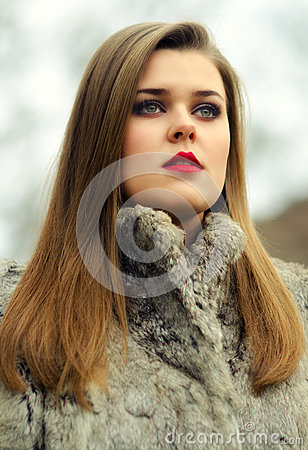 Portrait of the glamorous brunette in fur coat Stock Photo