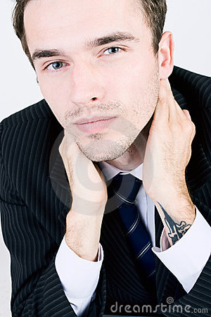 Portrait of good looking businessman in suit