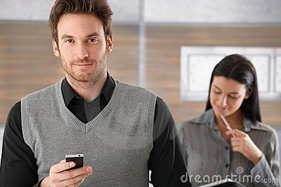 Portrait of goodlooking businessman with mobile