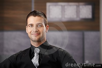 Portrait of goodlooking businessman smiling
